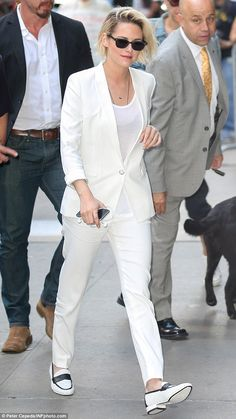 Snazzy: The film vet wore a white suit with black-and-white loafers for her sit down outsi...