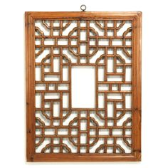 This lovely little wooden lattice panel, with its beautiful geometric pattern, would one have formed part of an interior divider in a home in Shanxi province, central China. A simple brass ring has been added to the top frame so that today the panel can be hung as an interesting decorative wall panel.
