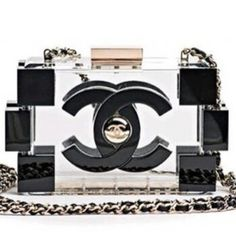 CHANEL Spring/Summer 2013 'Lego' Clutch - If there's anything to learn from Chanel's 'Les Secrets du Sac' exhibition (Singapore), which will open to the public on 10 November, it's that Chanel never fails to surprise as far as their bags are concerned. Which brings us to this bag that will only be released next year.