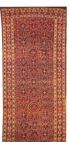 A Beshir long carpet (has been cut and reduced) size approximately 8ft. 7in. x 27ft. 3in.