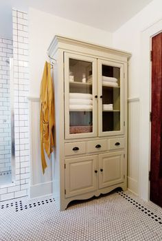 traditional bathroom by Keep Smiling Home - great reuse of an obsolete piece of furniture - the media cabinet!