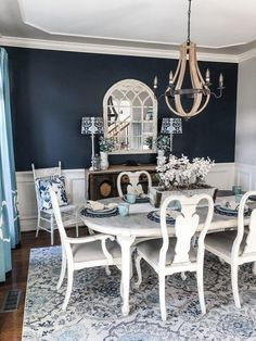 Navy paint on an accent wall brought a bold pop to my dining room transformation! Navy paint on an accent wall brought a bold pop to my dining room transformation! Dining Room Blue, Elegant Dining Room, Dining Room Walls, Dining Room Design, Dining Decor, Dining Tables, Grey Dining Room Furniture, Dining Room Office, Dining Room Fireplace