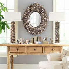DIY oyster shell mirror:http://www.completely-coastal.com/2010/03/making-oyster-shell-mirror-from.html