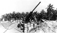 The 90mm antiaircraft guns on Rendova, as this one, threw up a barrier of fire to protect the troops attacking Munda airfield from enemy air raids and, in doing so, showered shell fragments on the Marines across New Georgia at Rice Anchorage. Department of Defense photo (USMC) 60625