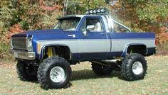 blue lifted Chevrolet truck