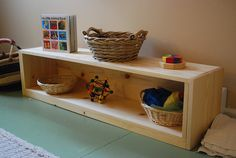 """DIY Montessori Infant Shelf  So I guess the idea here is to have a """"self-service"""" play area where infants can help themselves rather than having to be handed a toy."""