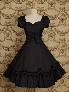 Adrienne OP by Mary Magdalene    In Black or maybe Raspberry.  This dress has so much fine detail.