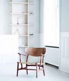 Carl Hansen & Søn has reintroduced Danish designer Hans J Wegner's CH22 lounge chair – one of the first pieces he originally designed for the furniture company in 1950.