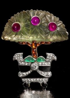 """A rock crystal and gem-set """"Orange Tree"""" brooch, by Cartier, 1914. The…"""