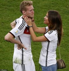 Tears of joy: A weepy Andre Schurrle is congratulated by his girlfriend Montana Yorke after the match
