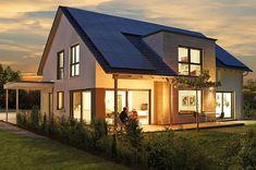 Ein Haus, viele Möglichkeiten. - Das Satteldachhaus besticht durch eine moderne Außenansicht mit dunkler Dacheindeckung, heller Putzfassade, einem Flachdacherker mit Sandst...