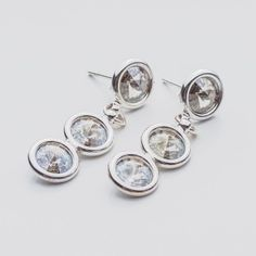 Swarovski Rivoli Earrings 6/6/6mm Silver Shade  Dimensions: length: 3,2cm stone size: 6mm Weight ( silver) ~ 3,30g ( 1 pair ) Weight ( silver + stones) ~ 3,95g Metal : sterling silver ( AG-925) Stones: Swarovski Elements 1122 SS29 ( 6mm ) Colour: Silver Shade 1 package = 1 pair  Price 9 EUR Sterling Silver Earrings Studs, Diamond Earrings, Silver Jewelry, Stud Earrings, Swarovski, Shades, Crystals, Colour, Stone