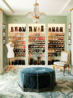 "Drawings by Manolo Blahnik flank dozens of the designer's (among others) shoes and boots; ""Karina"" chandelier, Nancy Corzine ottoman and Ann Getty chair; a dress form features one of Lake's antique evening bags, from Neiman Marcus."