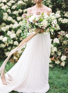 Feminine, dainty and whimsical, we love the look of long strands of ribbons falling from a beautiful bunch of flowers.