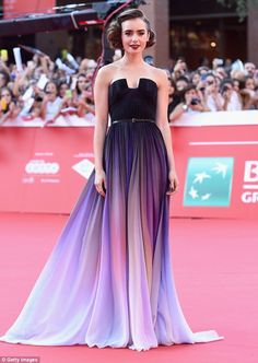 Lily in the purple: Actress Lily Collins made a showstopping appearance at the Love, Rosie premier in Italy on Sunday/ I am obsessed with this dress!!!!!