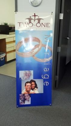 """This banner is fabricated on a specialty """"no-curl"""" banner that is almost like a thick paper. We then laminated it, put grommets in the four corners and then mounted to a specialty X-stand from Orbus. Very nice eye-catching piece! Monument Signs, Display Banners, Sign Company, Four Corners, Banner Printing, Letter Wall, Printing Process, Marriage, Lettering"""