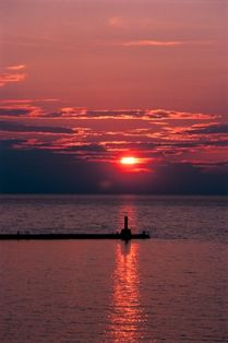 Beautiful sunset overlooking the breakwall from Sunset Park in Petoskey, Michigan