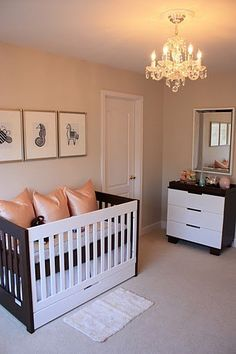 Sophisticated peach nursery. Something about a chandelier that simply says glam, glam, glam.