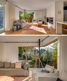 Inside this Australian home, the living area, dining and kitchen all share the same space that's open to the backyard. A built in fireplace and television make for a cozy living room, and when it gets too sunny, curtains can be drawn to provide shade.