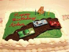 Race Car Birthday Cake: My 4 year-old son played with toy race cars and loved Oreos. I didn't use a special pan. I baked a cake and covered it with a nice design of frosting.