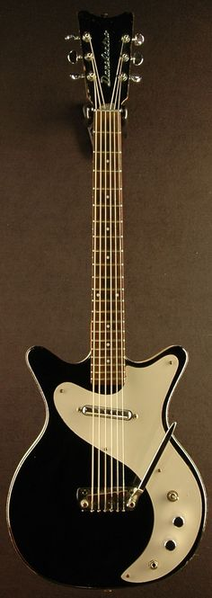 1959 Vintage Danelectro 4011 Guitar ~Hand Vibrato (note the soft V headstock and chrome emblem) #vintageguitars