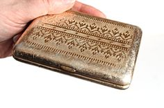 This excellent cigarette case dates back to 1960s . Its design features beautifully detailed relief embroidery pattern on both sides of the case. This cigarette case is made of golden tone metal. Although showing some signs of wear, overall it is in good vintage condition.  MEASUREMENTS: 3,9 (10cm) * 3,1 (8cm)