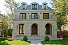 home exteriors - French second empire limestone home exterior juliet balcony arched doors  Winnetka, Illinois  Beautiful French second empire