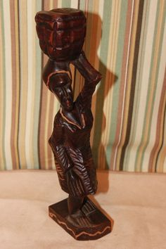 vintage hand carved wooden woman with basket statue