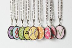 Embroidered initial necklaces by The Merriweather Council.  These initial necklaces make a great gift.