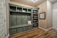 Mudroom with porcelain tile flooring and beautiful built-ins.  #mudrooms homechanneltv.com