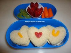 "Put all of those cookie cutters in your cabinet to use with a trio of ""I heart u"" sandwiches that will fill your tot's heart with joy when she opens her lunch box on Valentine's Day. Source: Bento School Lunches"
