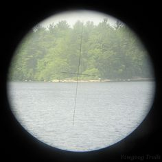 The towers have eyes! View of the tip of Phillips Island through the binoculars at the Medicine Bow Waterfront tower.  Camp #Yawgoog, Rockville, Hopkinton, Rhode Island (RI).  A 2014 image by David R. Brierley.