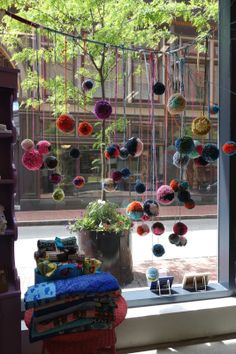 Colorful pom poms for window display yarn display, craft stall display, c. Craft Shop, Craft Stores, Deco Cafe, Yarn Display, Store Window Displays, Booth Displays, Retail Displays, Merchandising Displays, Wool Shop