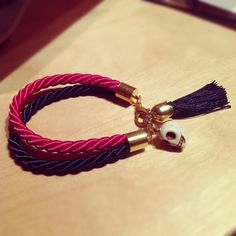 Beautiful bracelet with skull bead and a mini tassel.