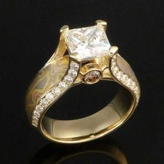 Sculptural prongs set a cushion-cut sapphire into a Mokume Gane band adorned with diamonds. This unique handcrafted engagement ring is made to order. Heart Ring, Jewelry Bracelets, Wedding Rings, Engagement Rings, Jewels, Crystals, Stone, Princess Cut, Champagne
