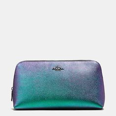 A shimmering, iridescent finish creates a hologram effect on our large cosmetic case, a beautifully crafted piece in textured crossgrain leather. Perfect for stowing cosmetics and other small essentials, it makes a great travel companion—and a fun and stylish addition to any vanity.