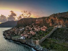 Monemvasia, a well-preserved Byzantine gem, is a magnificent castle town located on a small island off the east coast of the Peloponnese. #Monemvasia #Peloponnese #Greece #Monterrasol #travel #privatetours #customizedtours #multidaytours #roadtrips #travelwithus #tour #landscape #nature #sea #sun #sunset #summer #summertime #beauty #beautiful #tourism #thisisgreece #destination #wall #architecture #Byzantine #rock Monemvasia Greece, Alpine Mountain, Places In Greece, Small Island, Day Tours, Continents, East Coast, Grand Canyon, Summertime