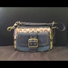 COACH Shoulder Bag Cute Coach shoulder bag; canvas and leather. Little wear from normal use. No holes, rips, stains or bad smells. No holds, trades, or non pm transactions. Reasonable offers accepted via offer button. Coach Bags
