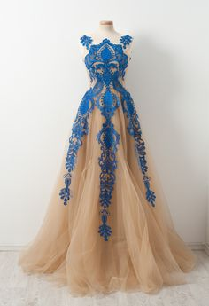 Indulge yourself with a light tulle glaze dessert with blue sherbet embroidery. Wear it while you learn to waltz.