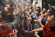 """The St. Louis Cardinals' Rafael Furcal, center, leads his teammates in the """"Happy Flight"""" chant, which he coined during last year's World Series season, following a 6-3 victory over the Atlanta Braves in the National League Wild Card game at Turner Field in Atlanta, Georgia, Friday, October 5, 2012. The Cardinals will play the Washington Nationals in a National Leauge Division Series. (Chris Lee/St. Louis Post-Dispatch/MCT) Photo: Chris Lee, McClatchy-Tribune News Service / SF"""