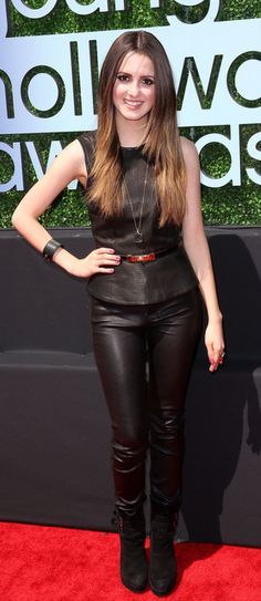 Laura Marano in a THEORY Leather Elleria top and leather Vince Jeans trousers.