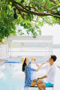 Sharing a fun moment in this tropical engagement shoot by the pool // Pop Art Poolside Engagement Inspiration