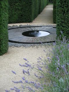 circular water feature in a garden axis point. Pinned to Garden Design - Water Features by Darin Bradbury.Beautiful circular water feature in a garden axis point. Pinned to Garden Design - Water Features by Darin Bradbury.