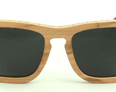 Wooden Sunglasses handmade from upcycled skateboards by Wooden Sunglasses, Scorpion, Skateboards, Eyewear, Upcycle, Trending Outfits, Unique Jewelry, Handmade Gifts, Vintage