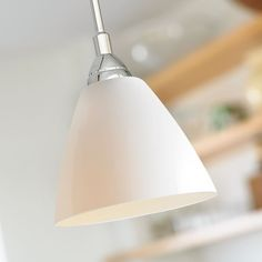 The Read 14 Pendant Light by Nordlux, has a Opal White Glass Shade with Polished Chrome Detail. It's Simple Design Compliments Contemporary Living. Nordlux 73153010
