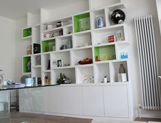 Alluring White Bookshelves Design With Impressive Shelving Design Like A Labyrinth Also Storages Below
