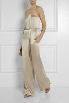 KAUFMANFRANCO Strapless brushed-silk jumpsuit $1,995 EDITOR'S NOTES KAUFMANFRANCO's brushed-silk jumpsuit can be worn with or without the narrow waist belt, depending on whether you want a fluid or more defined look. Fitted with boning and support at the bust, and loose at the hip, it's a perfect choice for curvy frames. Play up the lustrous neutral hue with metallic accessories.