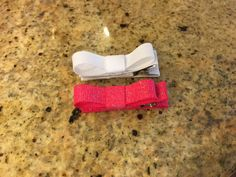 Two adorable hair clips. Set of sparkly bright pink and sparkly white. Ribbon covered clip with non slip material inside. Please inquire about other colors