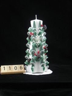 Hand Carved Candle White and Green, Christmas Tree Carve with Pine Cones, 7 Inch, OOAK is available at $28.00 https://www.etsy.com/listing/492697531/hand-carved-candle-white-and-green?utm_source=socialpilotco&utm_medium=api&utm_campaign=api  #candles #pillar
