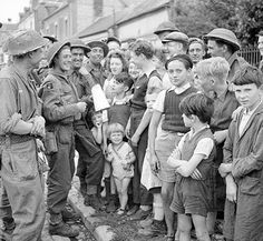 Members of the Green Howards Talking to French Cilivians,23rd August 1944